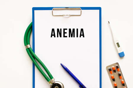 Text ANEMIA in the folder with the stethoscope. Medical concept photo