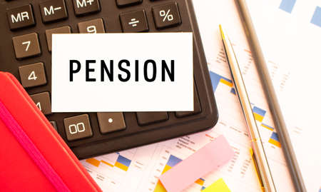 Text PENSION on white card with metal pen, calculator and financial charts. Business and financial concept
