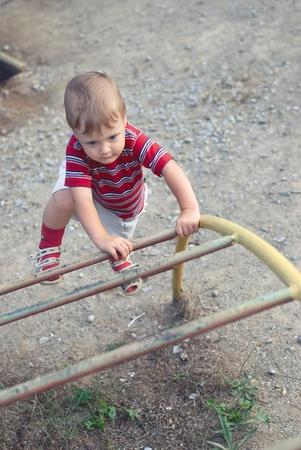 a little boy on playground photo