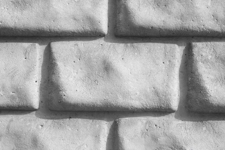 a light grey brick wall  photo