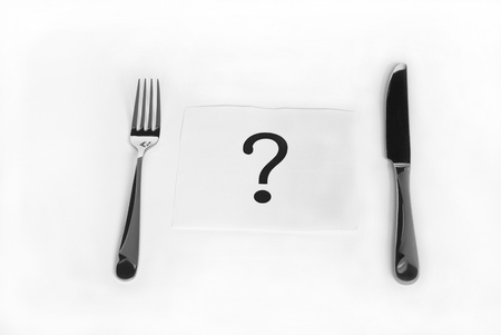 eating questions: Question mark between fork and knife