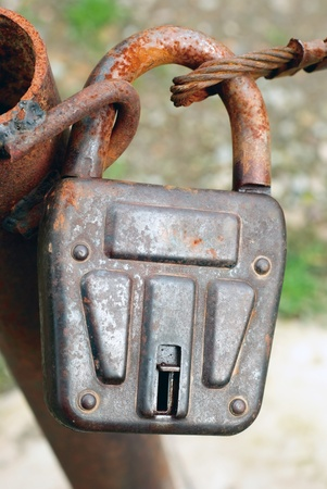 durty: a closed durty rusty lock Stock Photo