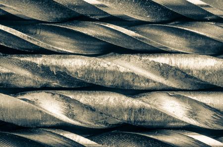 broach: Five drill bits in monochrome