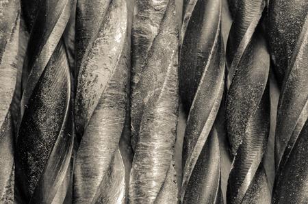 broach: Unclean drill bits in monochrome