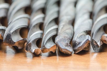 broach: Drill bits on wood board