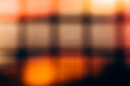 glass block: Abstract blurred background of glass block wall. Yellow-red bokeh Stock Photo