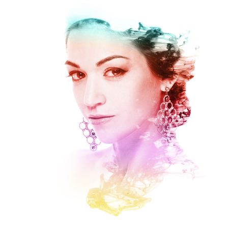 Double exposure of a beautiful woman and cloud of color ink