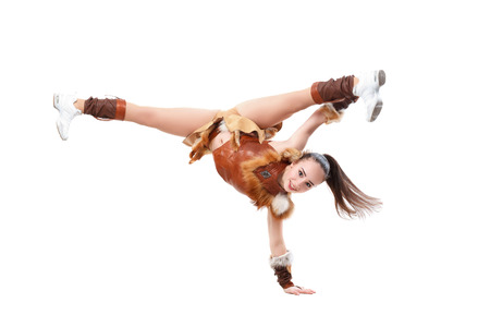 splits: Young professional cheerleader dressed in a warrior costume standing on one hand. Horizontal splits