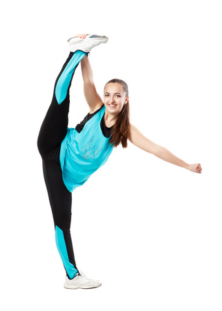 splits: Young professional cheerleader  stands in vertical splits. Isolated over white.