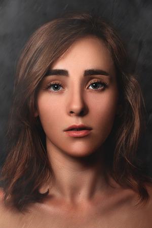 bushy: Close Up dramatic portrait of a young girl on a dark background. low key. dark art
