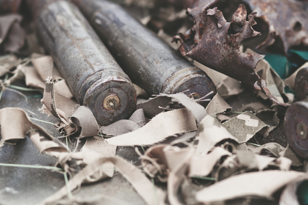 casings: bullet shells from heavy machine gun on the table with camouflage netting Stock Photo