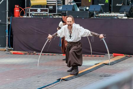 cossacks: Dneprodzerzhinsk, Ukraine - October 15, 2016: theatrical performance of Ukrainian cossacks, dances and elements of combat with sabers