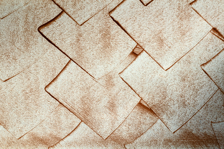 rhomb: Copper rhomb on a white wall, background texture