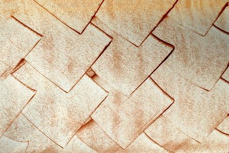 rhomb: Copper rhomb on a white wall Stock Photo