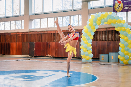 duet: Dneprodzerzhinsk, Ukraine - November 12, 2016: Qualifying round for the cheerleading competition. Cup Prometheus , young cheerleaders perform at the city cheerleading championship
