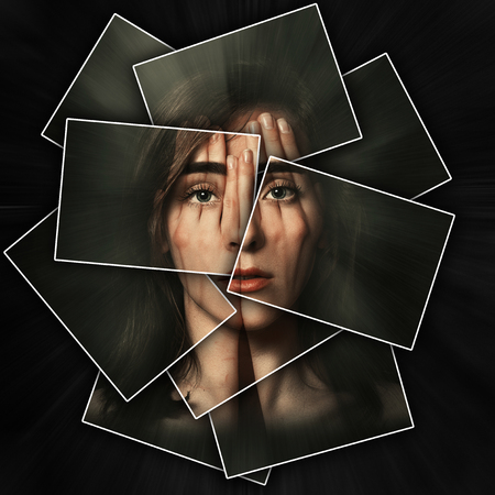 Surreal portrait of a young girl covering her face and eyes with her hands, face shines through hands, face is divided into many parts by cards , double exposure