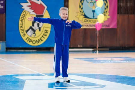 Kamenskoye, Ukraine - March 8, 2017: Championship of the city of Kamenskoye in cheerleading among solos, duets and teams, young boys cheerleaders perform at the city cheerleading championship Editorial