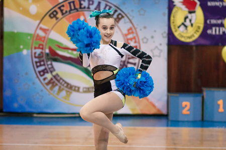 Kamenskoye, Ukraine - March 8, 2017: Championship of the city of Kamenskoye in cheerleading among solos, duets and teams, young cheerleaders perform at the city cheerleading championship