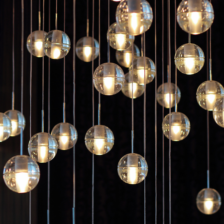 Lighting balls on the chandelier in the lamplight light bulbs 87545600 lighting balls on the chandelier in the lamplight light bulbs hanging from the ceiling lamps on the dark background selective focus aloadofball Image collections