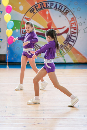 Kamenskoye, Ukraine - March 9, 2017: Championship of the city of Kamenskoye in cheerleading among solos, duets and teams, young cheerleaders perform at the city cheerleading championship Editorial