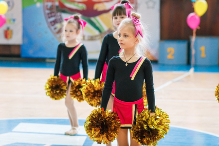 Kamenskoye, Ukraine - March 9, 2017: Championship of the city of Kamenskoye in cheerleading among solos, duets and teams, young cheerleaders perform at the city cheerleading championship 에디토리얼