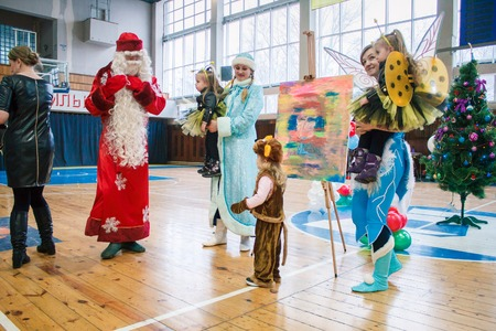 Kamenskoye, Ukraine - December 26, 2016: Christmas party for federation of cheerleading in Kamenskoye, Father Frost plays with children and leads a round dance Editorial