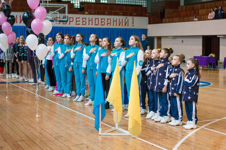 Kamenskoye, Ukraine - November 28, 2017: young athletes listen to the national anthem, сhampionship of the city of Kamenskoye in cheerleading among solos, duets and teams 에디토리얼