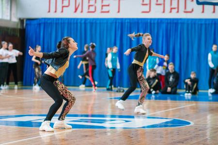 Kamenskoye, Ukraine - November 28, 2017: Championship of the city of Kamenskoye in cheerleading among solos, duets and teams, young cheerleaders perform at the city cheerleading championship 에디토리얼