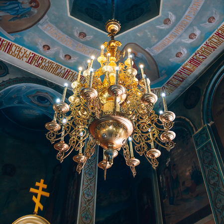 Dnipro, Ukraine - August 06, 2017: Church of St. Nicholas, large gold or bronze chandelier in the temple or cathedral, big bronze with handelier in the church, orthodox church inside Editorial