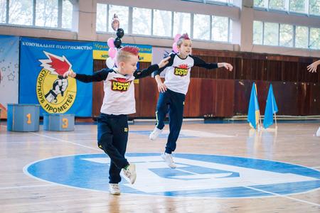 Kamenskoye, Ukraine - November 29, 2017: Championship of the city of Kamenskoye in cheerleading among solos, duets and teams, young boys cheerleaders perform at the city cheerleading championship
