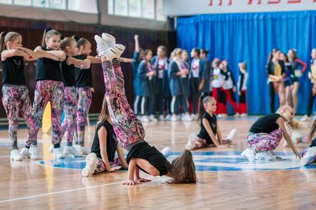 Kamenskoye, Ukraine - November 29, 2017: Championship of the city of Kamenskoye in cheerleading among solos, duets and teams, young cheerleaders perform at the city cheerleading championship