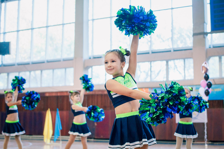 Kamenskoye, Ukraine - November 29, 2017: Championship of the city of Kamenskoye in cheerleading among solos, duets and teams, young cheerleaders perform at the city cheerleading championship