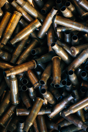 many empty bullet shells, pile of used rifle cartridges 7.62 mm caliber, assault rifle bullet shell, military background, top view