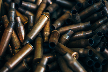 pile of used rifle cartridges 7.62 mm caliber, many empty bullet shells, assault rifle bullet shell, military background, top view Stock Photo