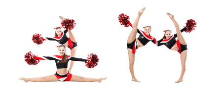 Two professional cheerleaders with pompoms posing at studio. Vertical split. Isolated over white. girl dancer practicing mixed dance and stretching, extending leg up, vertical twine, image set Imagens