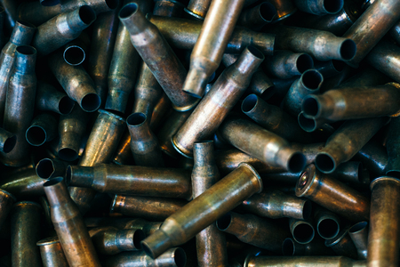 pile of used rifle cartridges 7.62 mm caliber, many empty bullet shells, assault rifle bullet shell, military background, top view Imagens