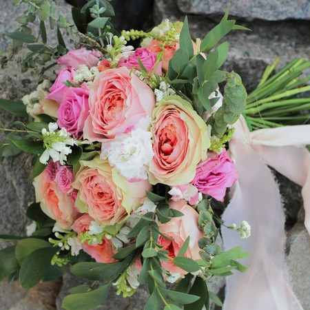 Bridal bouquet lying on the rocks