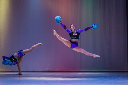 Kamenskoye, Ukraine - October 14, 2018: Championship of the city of Kamenskoye in cheerleading among duets and teams, young cheerleaders perform at the city cheerleading championship