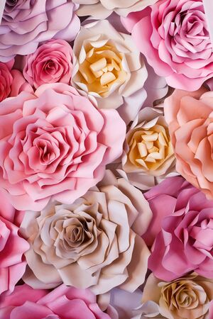 Colorful flowers paper background. Red, pink, purple, brown, yellow and peach handmade paper roses Imagens - 137308804