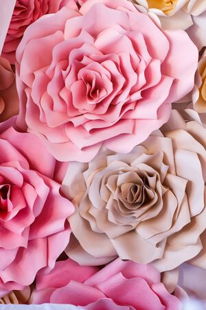 Colorful flowers paper background. Red, pink, purple, brown, yellow and peach handmade paper roses