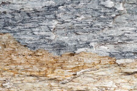 Detailed stone surface texture, blue and brown marble slabs with cracks, detailed structure of stone in natural patterned for background and design.