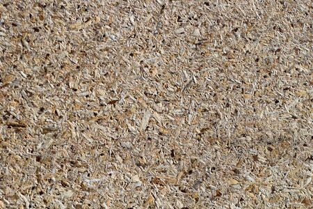 osb - oriented strand board or qsb - quаlity strаnd bоard, chipboard texture or chipboard background with copy space for text or image. Imagens