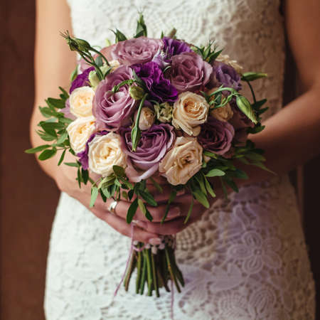 young beautiful bride in white dress holding wedding bouquet, bouquet of bride from rose cream spray, rose bush, rose purple Memory Lane, violet eustoma, eucalyptus.