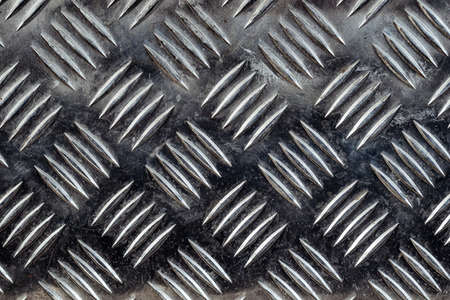 Diamond plate texture, background iron sheets with grooved notches, exterior floor covering in metal with engraved print, pattern style of steel floor for background,