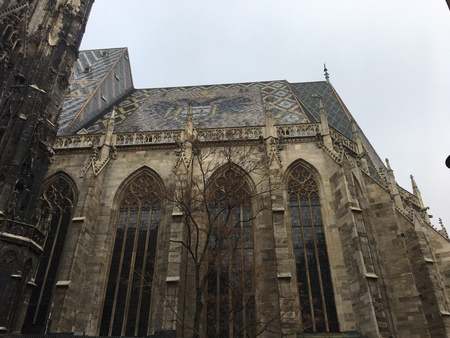 buttresses: View of the Saint Stephens Church facade. Gothic architecture  with highly decorative roof,