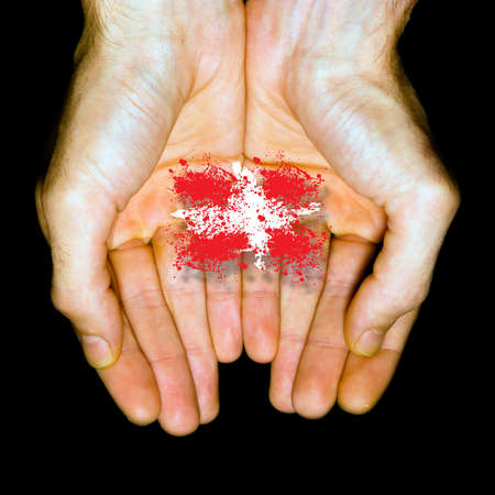 Made in Denmark, country flag in two hands  Stock Photo