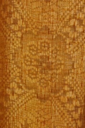 Sun shining through the ocher curtain Stock Photo