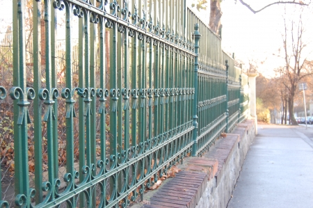 unobtrusive: Common tradicional ornamental fencing painted with green oil paint on Prague street