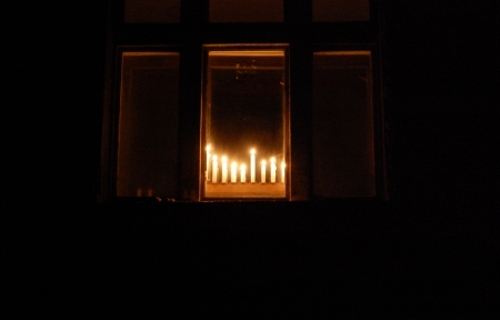 Hanukkah menorah in the window view from outside photo