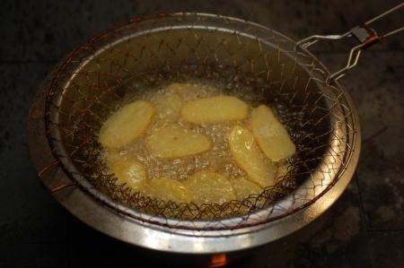 Potato slices in hot oil Stock Photo - 24596841